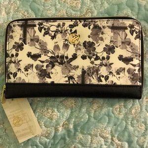 Adrienne Vittadini travel wallet passbook.